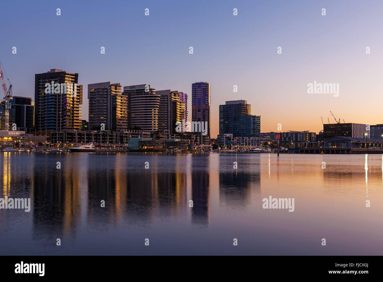 Docklands, Melbourne residential buildings and Yarra waterfront at dawn - Stock Image