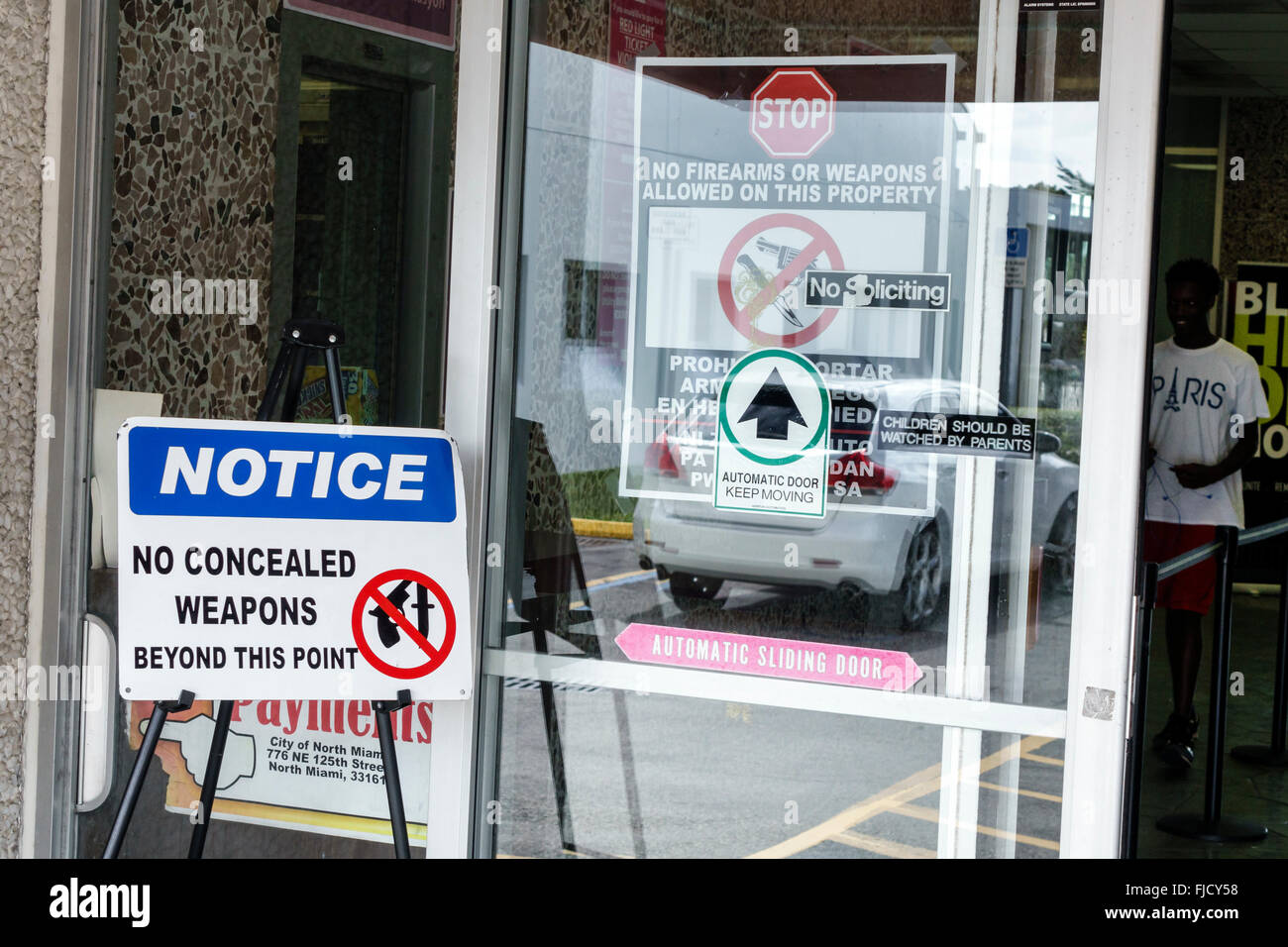North Miami Florida city administrative offices notice no concealed weapons beyond this point firearms not allowed - Stock Image