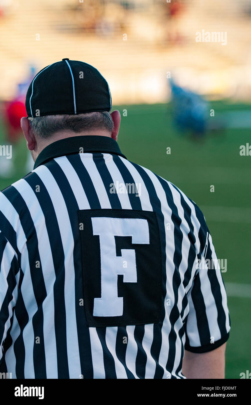 Referees manage college game - Stock Image