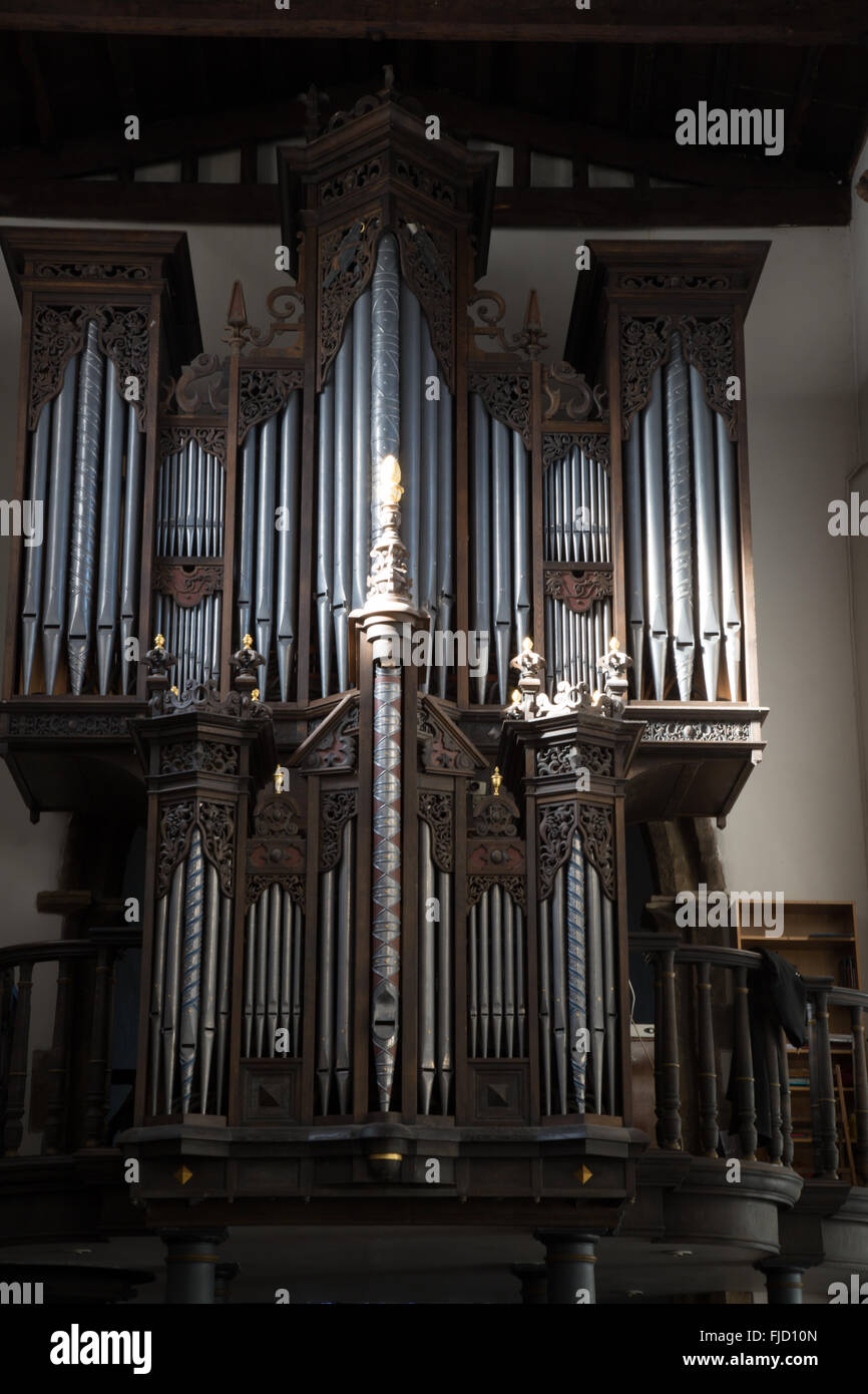 The church Pipe Organ situated in St. Oswald's Church, Durham, England. - Stock Image