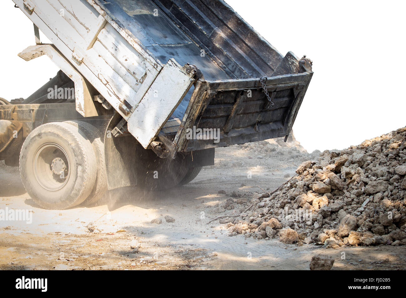 A photo of Truck land dumping a soil - Stock Image
