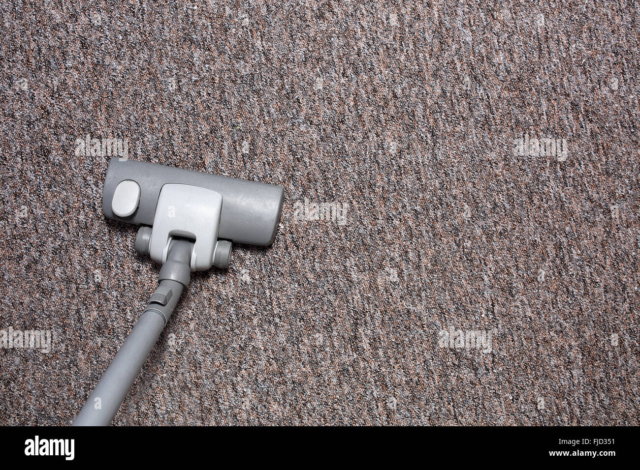 Vacuuming carpet Stock Photo