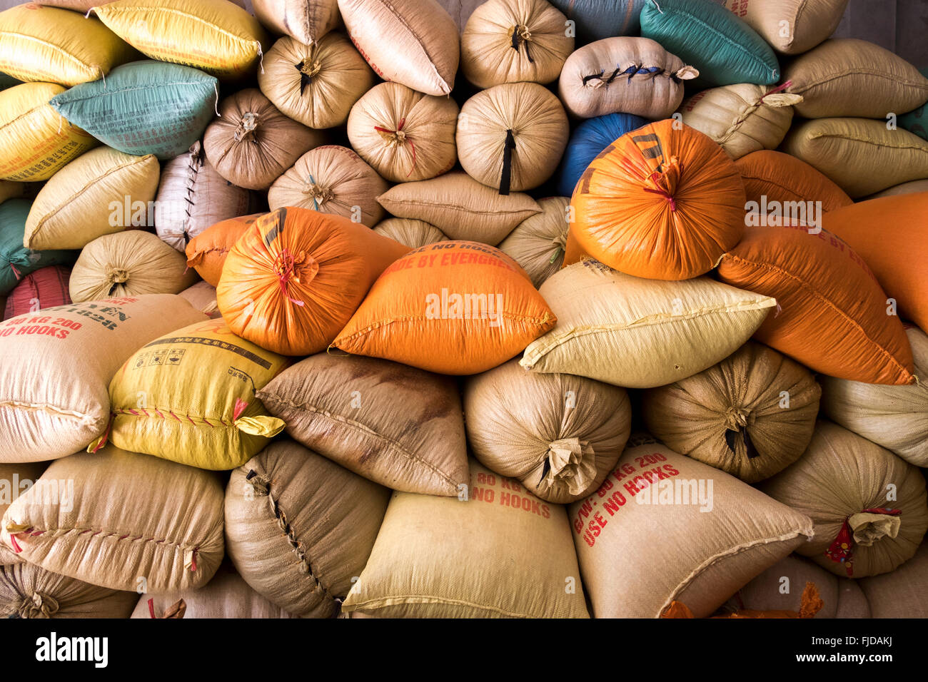 Sacks of rice are stacked at a warehouse in Ban Den, northern Vietnam - Stock Image