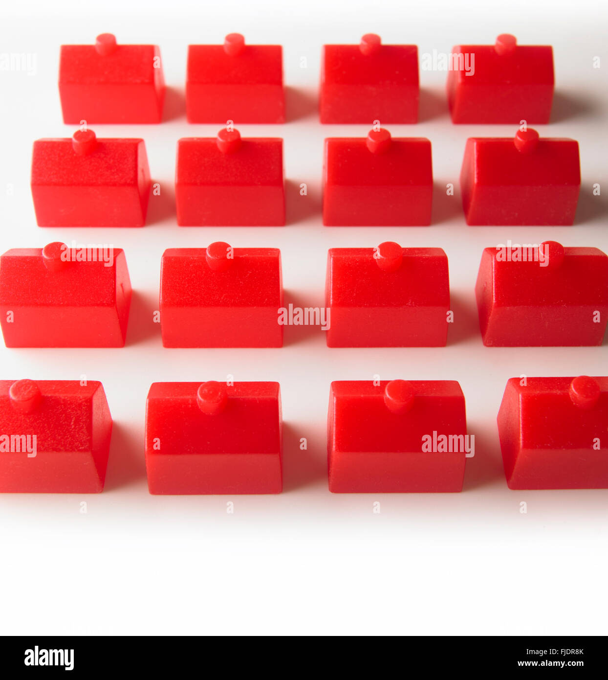 Identical red houses in a grid plan - Stock Image