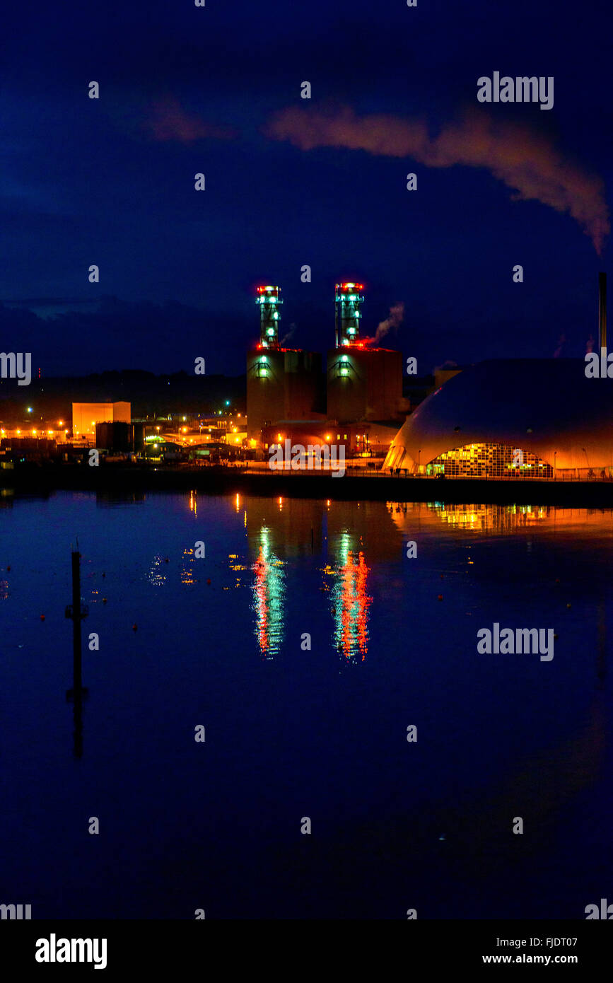 Southampton docks at night with reflections on Southampton Water - Stock Image