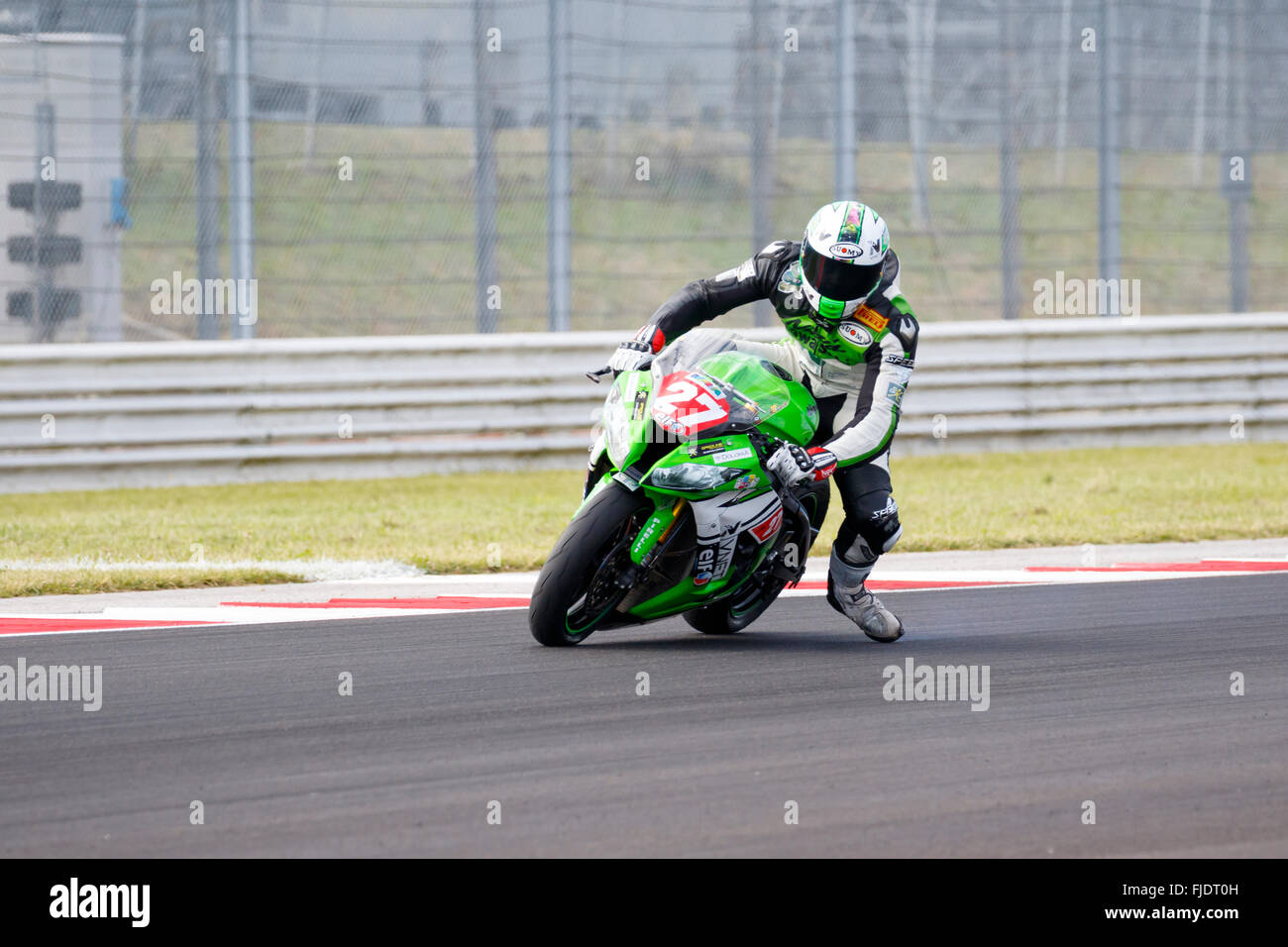 Misano Adriatico, Italy - June 21, 2015: Kawasaki ZX-10R of Pedercini Team, driven by CECCHINI Riccardo Stock Photo