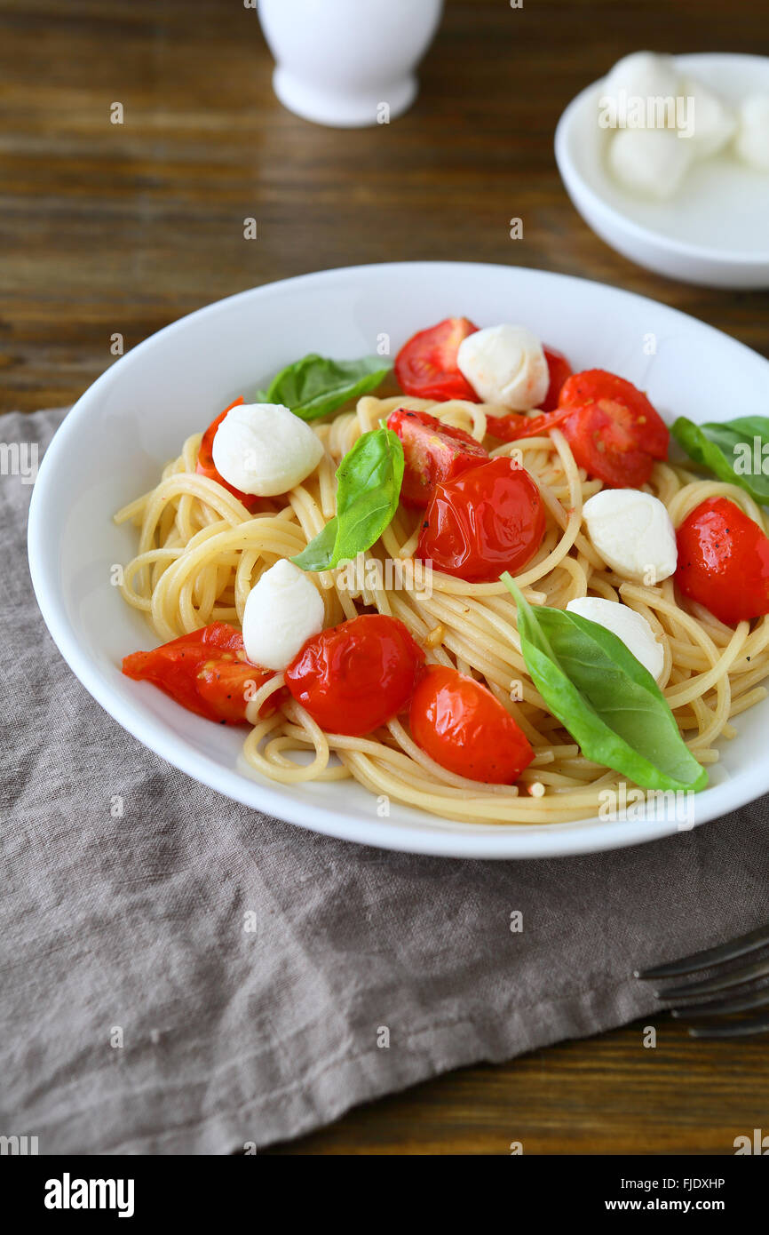 pasta with roasted tomatoes and cheese, food - Stock Image