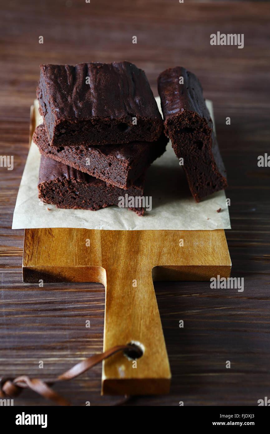 Brownie on a cutting board, food closeup Stock Photo