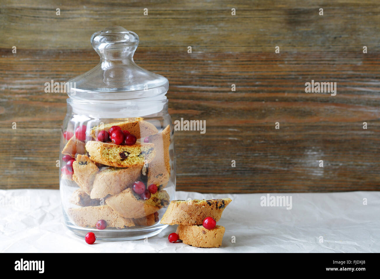 Cranberry biscotti cookies in glass jar - Stock Image