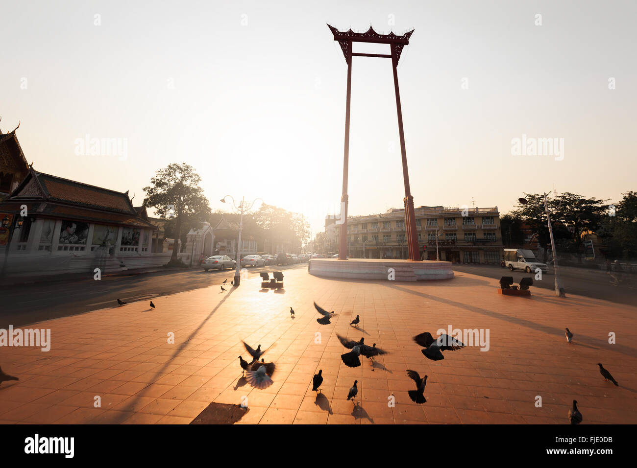 Sunlight with Giant swing which Thai people called 'Sao Ching Cha'. There are many pigeons live around this - Stock Image