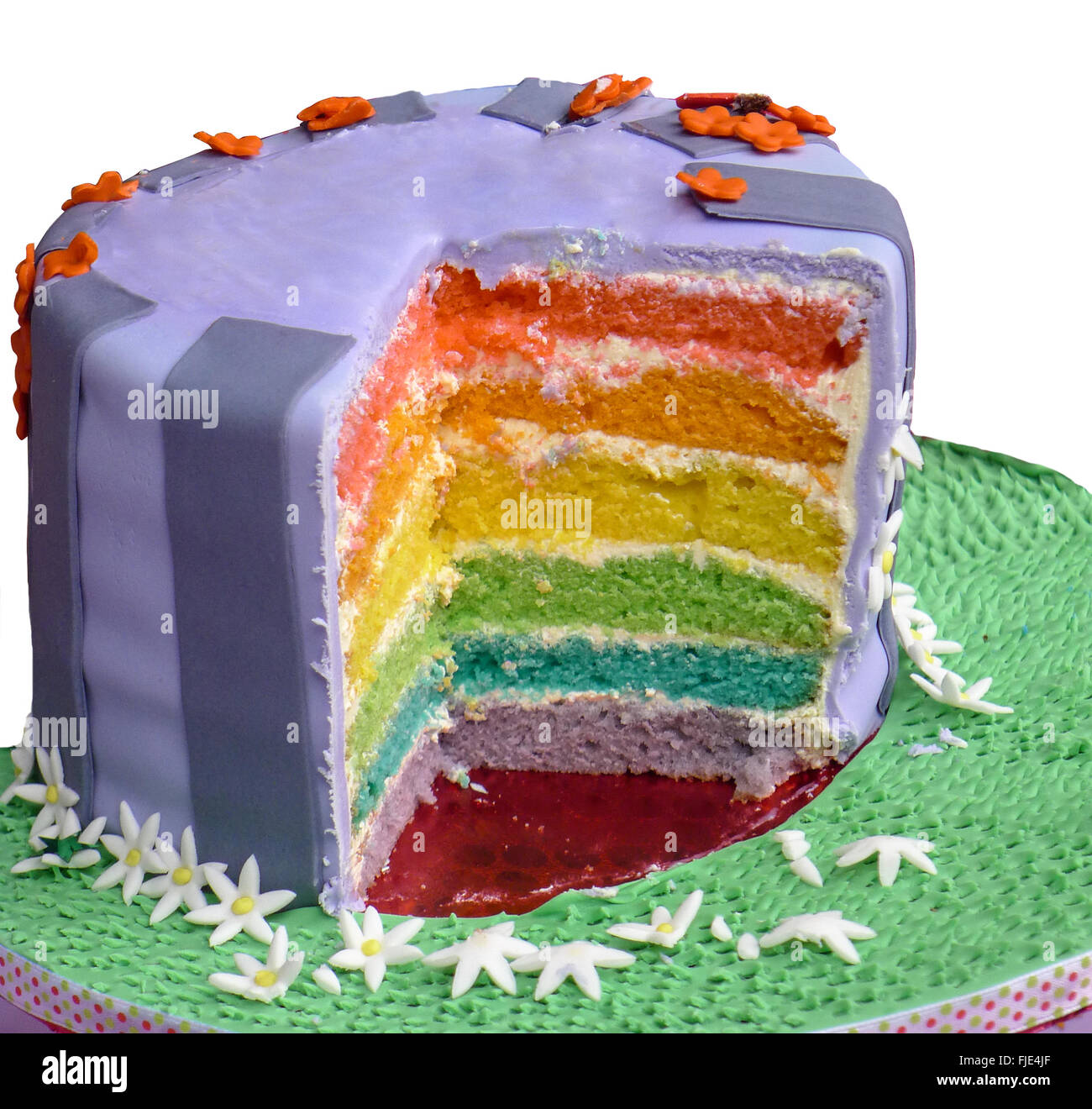 Multi-layered birthday cake with slice cut out to show layers - Stock Image