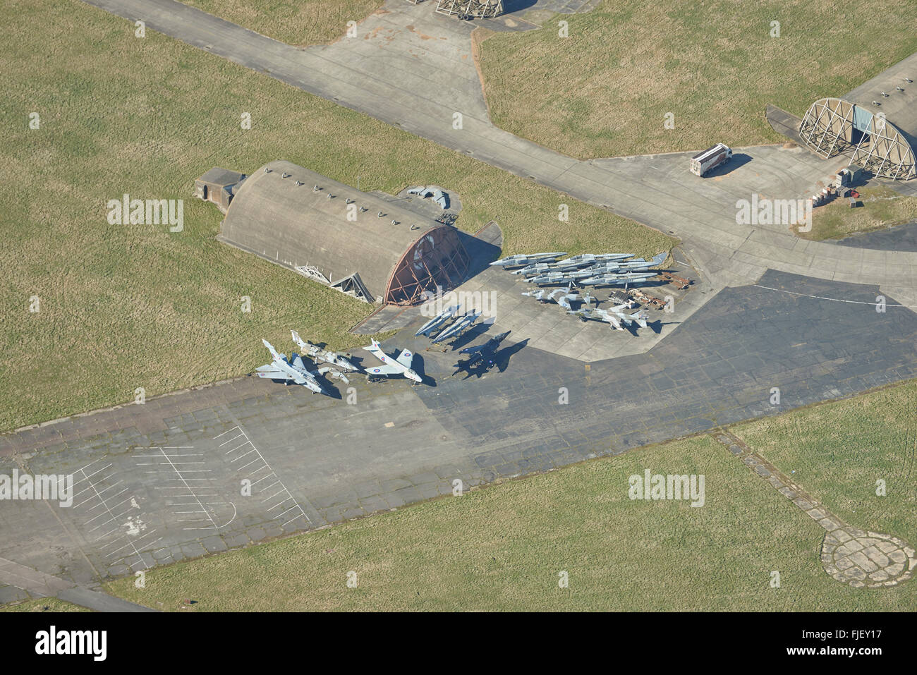 An aerial view of scrap military aircraft at an airfield in Suffolk - Stock Image