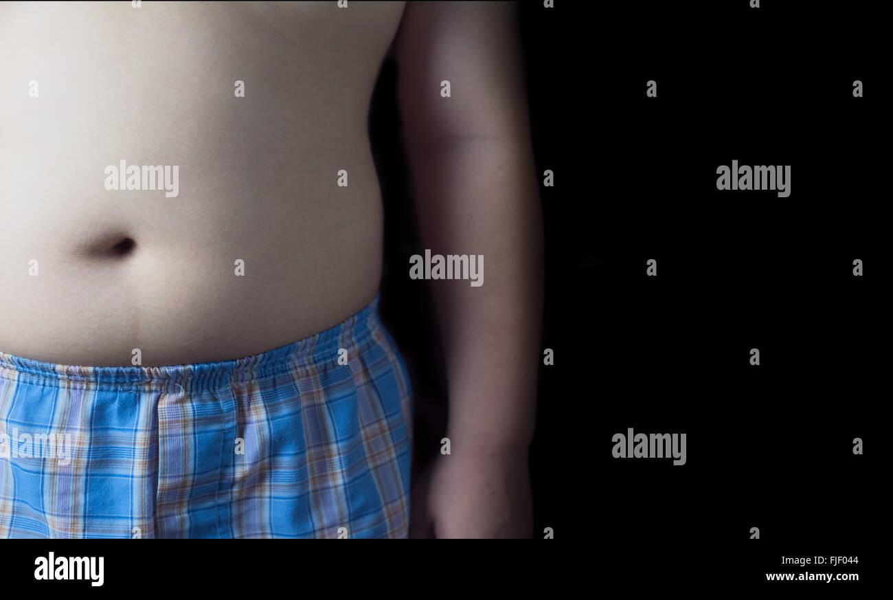 fat boy isolated on black background. Stock Photo