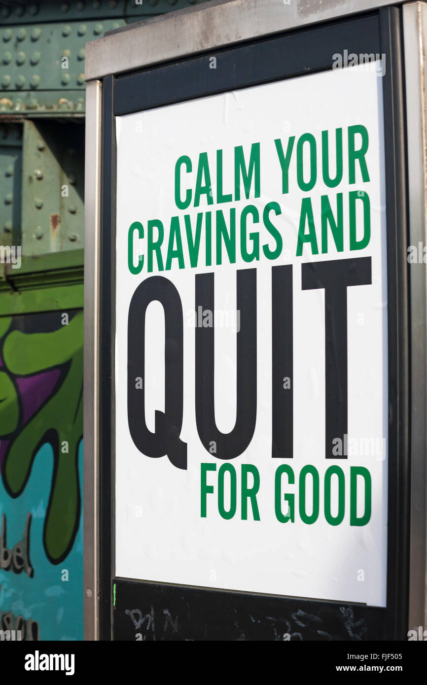 Calm your cravings and quit for good poster in telephone box - Stock Image