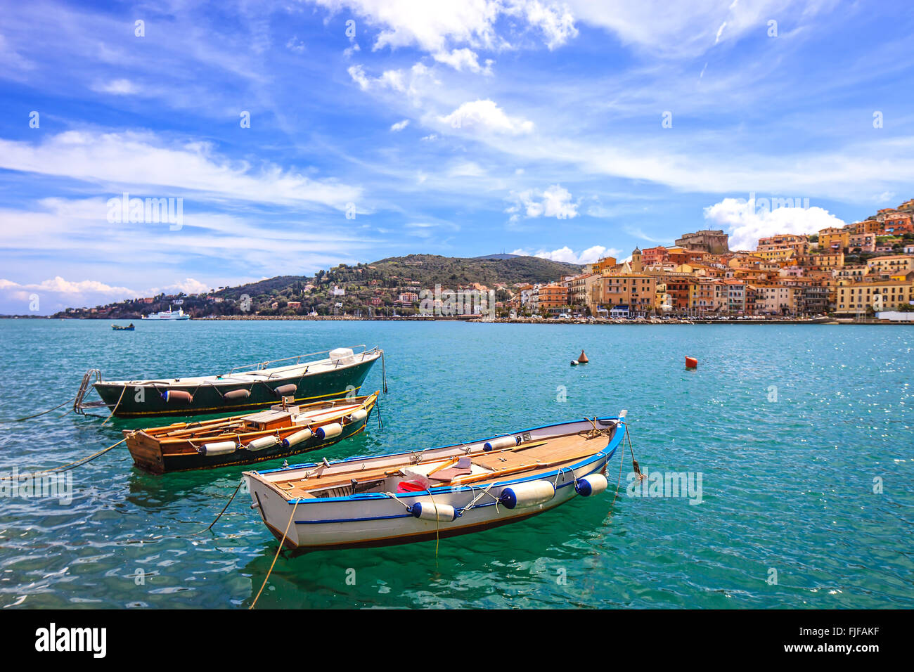 Wooden small old boats in Porto Santo Stefano seafront, italian travel destination. Monte Argentario, Tuscany, Italy. - Stock Image