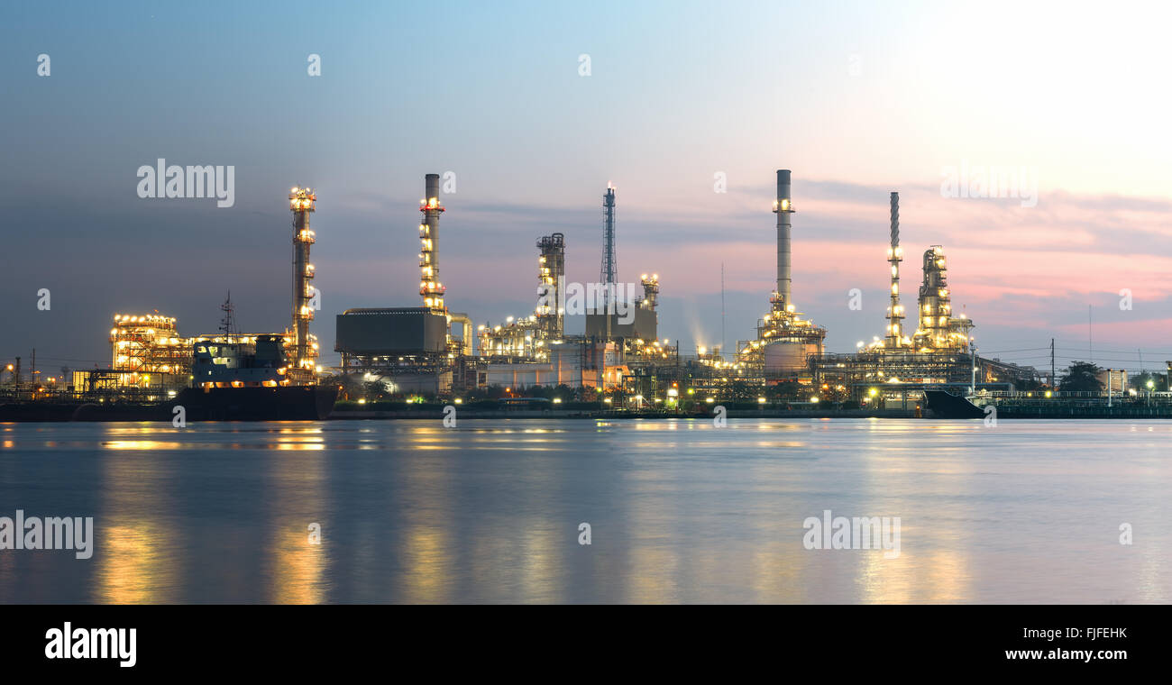 Tanker Oil refinery at twilight - Panorama picture - Stock Image