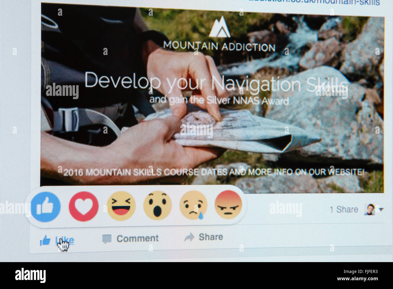 Close-up screenshot of Facebook website showing hand on LIKE with new reactions emoji on a business page. England - Stock Image