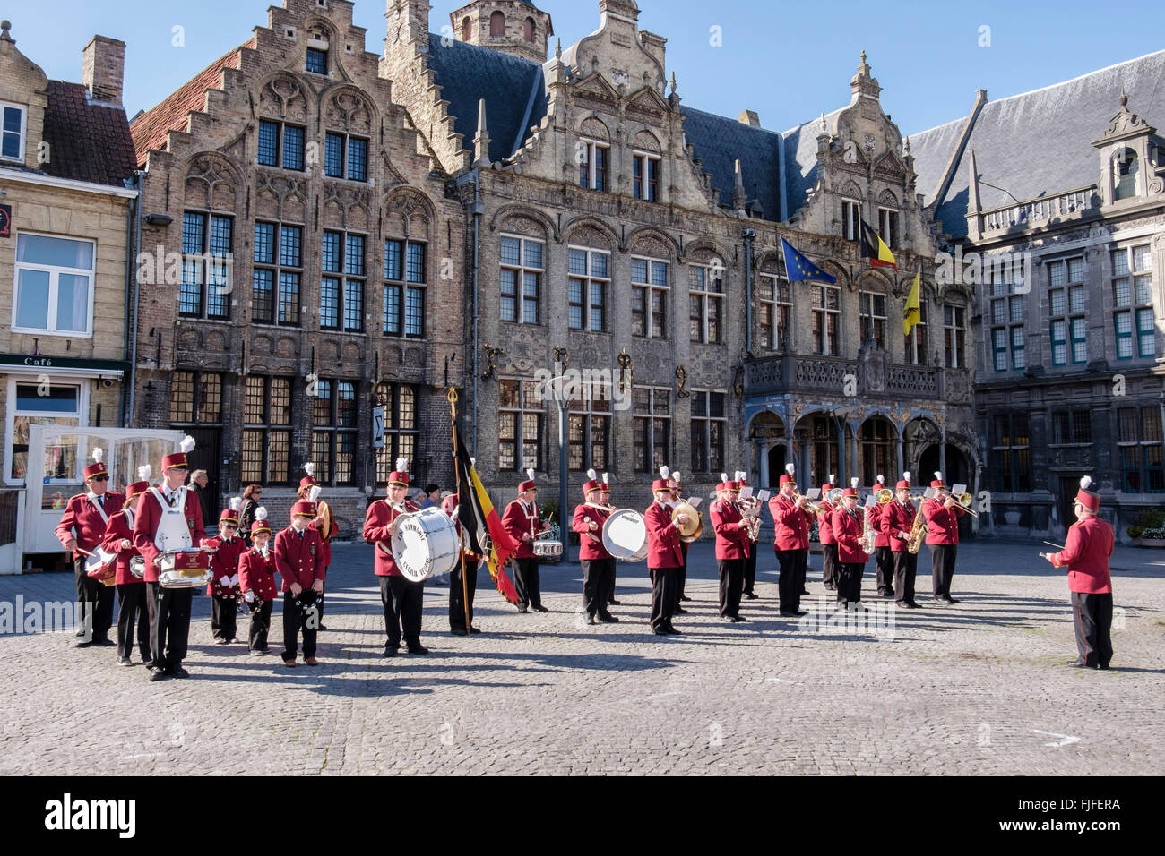 Men and young boys in the St Cecilia Kon Harmonie Band wait to play their instruments in Grote Markt, Veurne, Belgium - Stock Image