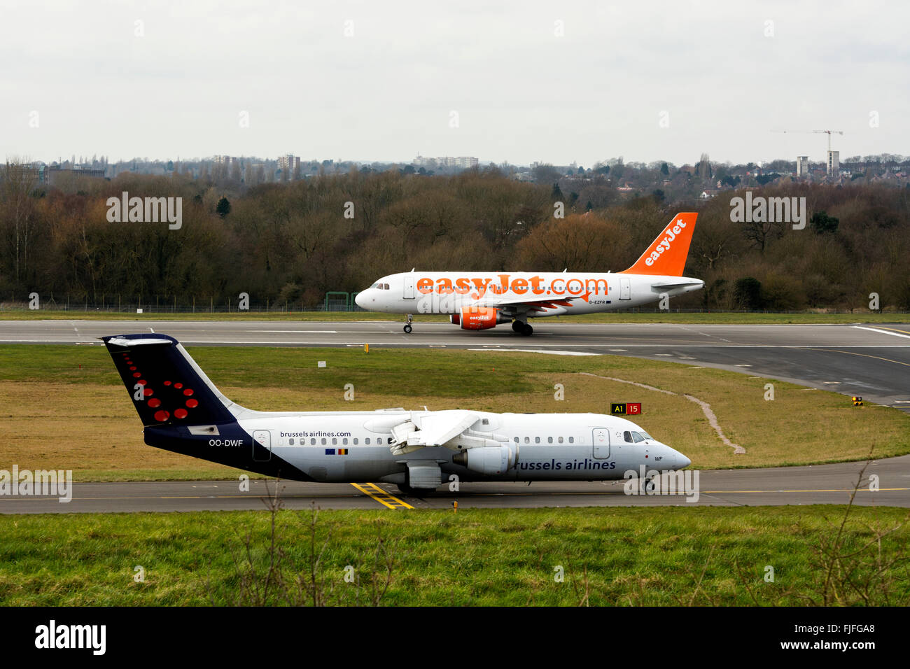 Brussels Airlines and Easyjet aircraft about to take off at Birmingham Airport, UK - Stock Image
