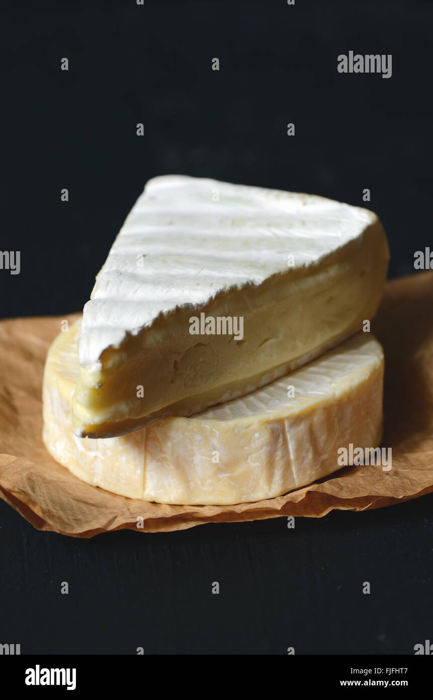 A Slice of Fresh Brie cheese, close up shot - Stock Image
