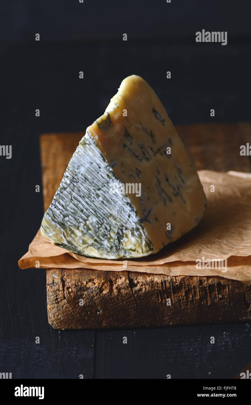 A Slice of Danish Blue cheese, close up shot - Stock Image