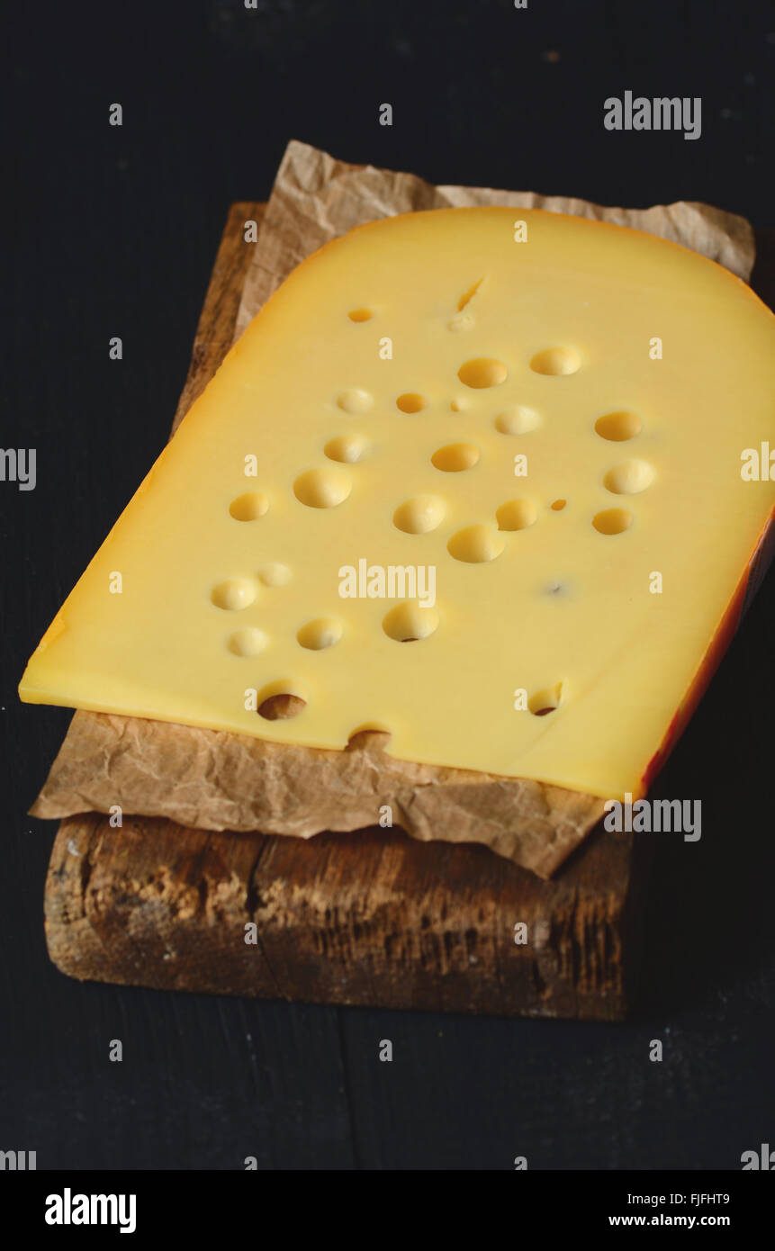 Piece of swiss cheese, close up image - Stock Image