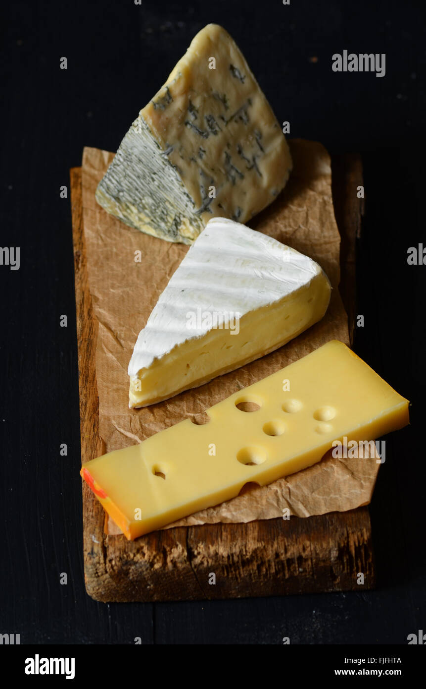 Different kinds of cheeses: emmental, brie,  blue cheese - Stock Image