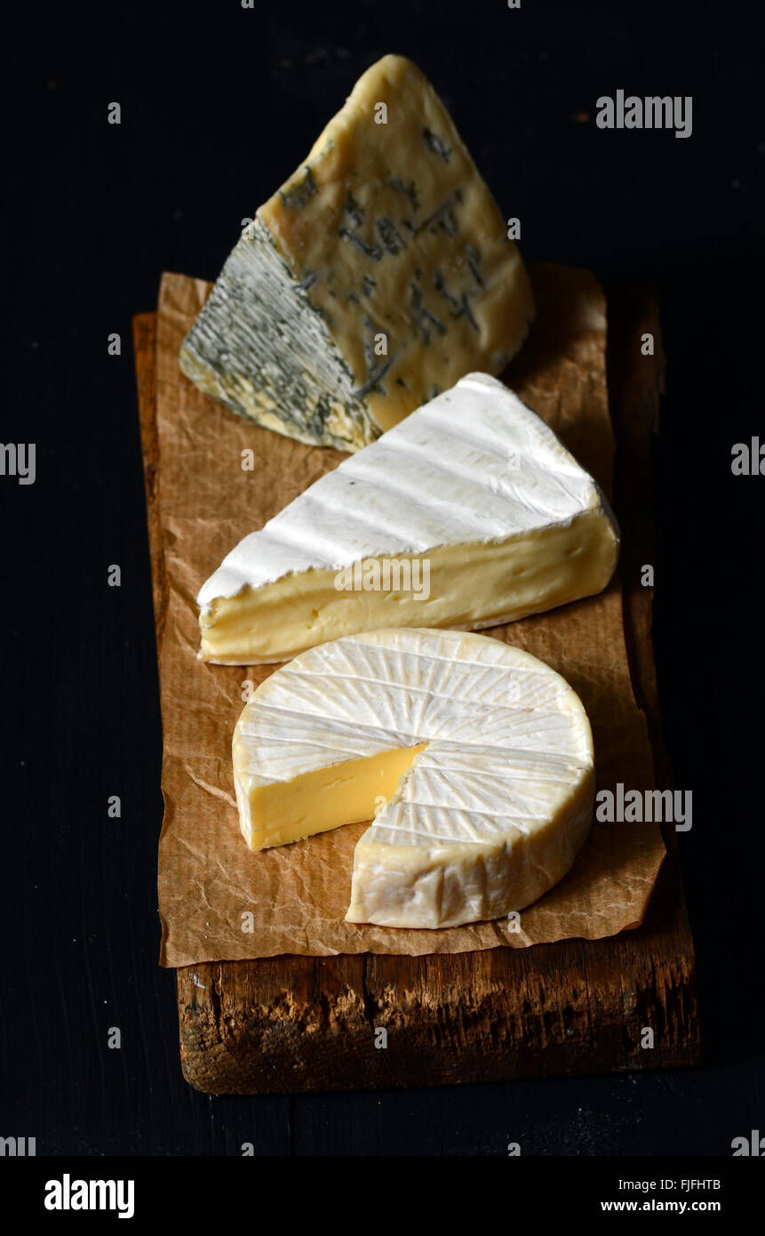 Different kinds of cheeses: camembert, brie,  blue cheese - Stock Image