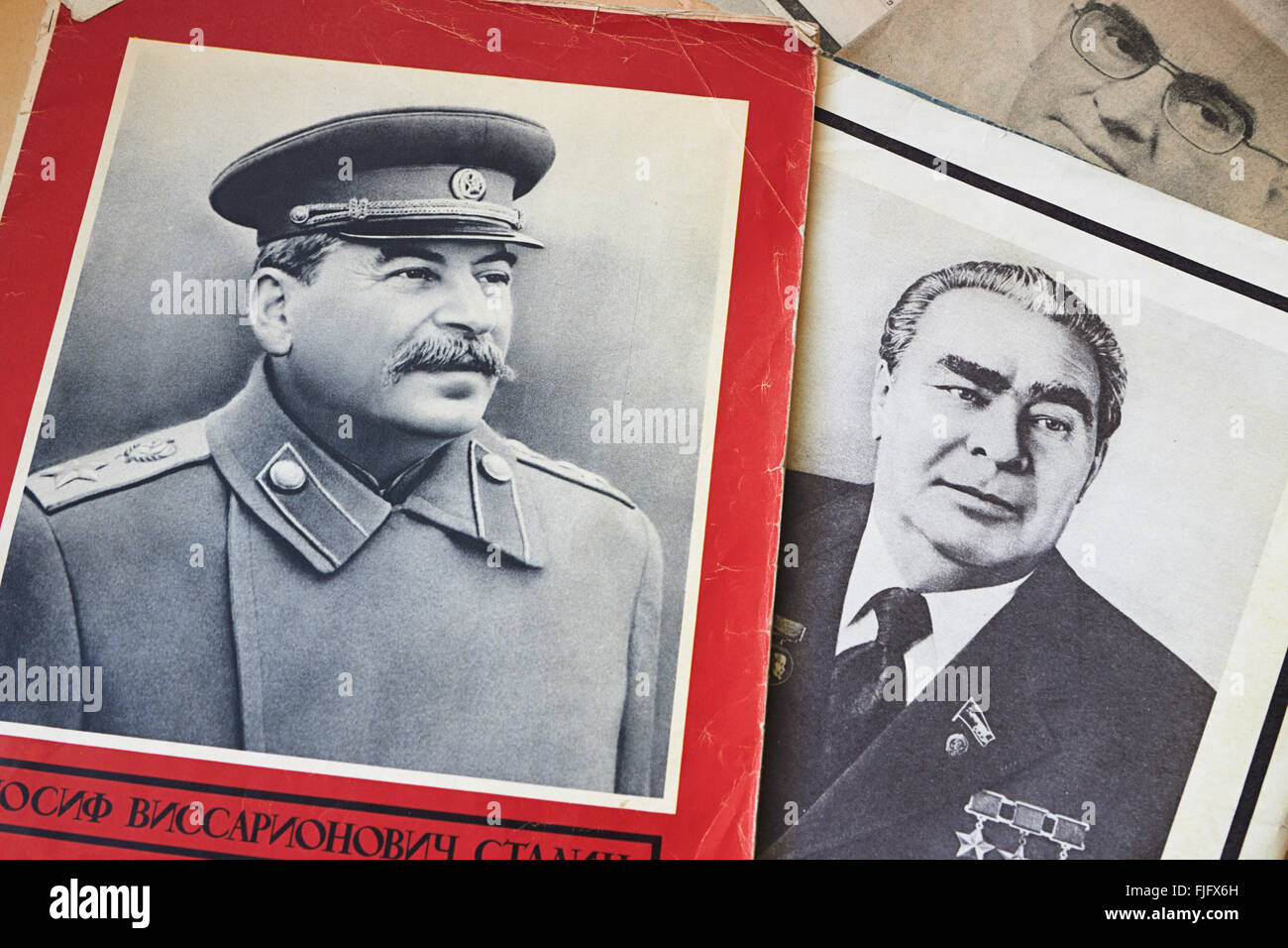 Mourning portraits of Stalin, Brezhnev and Andropov in old Soviet periodicals with news of the death of the leaders - Stock Image