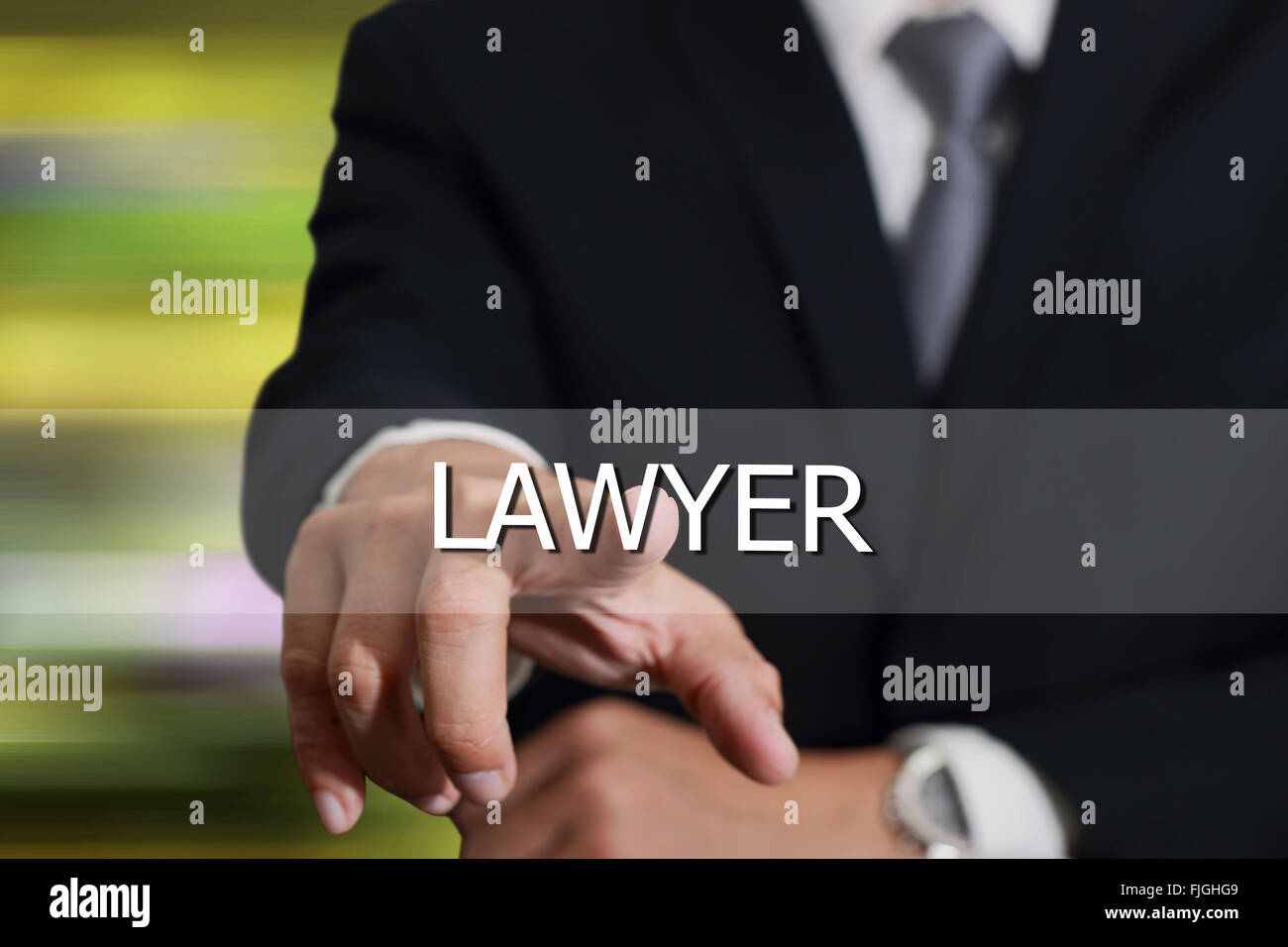 Businessman hand touching lawyer sign on virtual screen as justice concept. - Stock Image