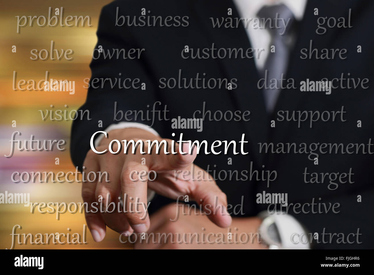 Businessman hand touching commitment concept. - Stock Image