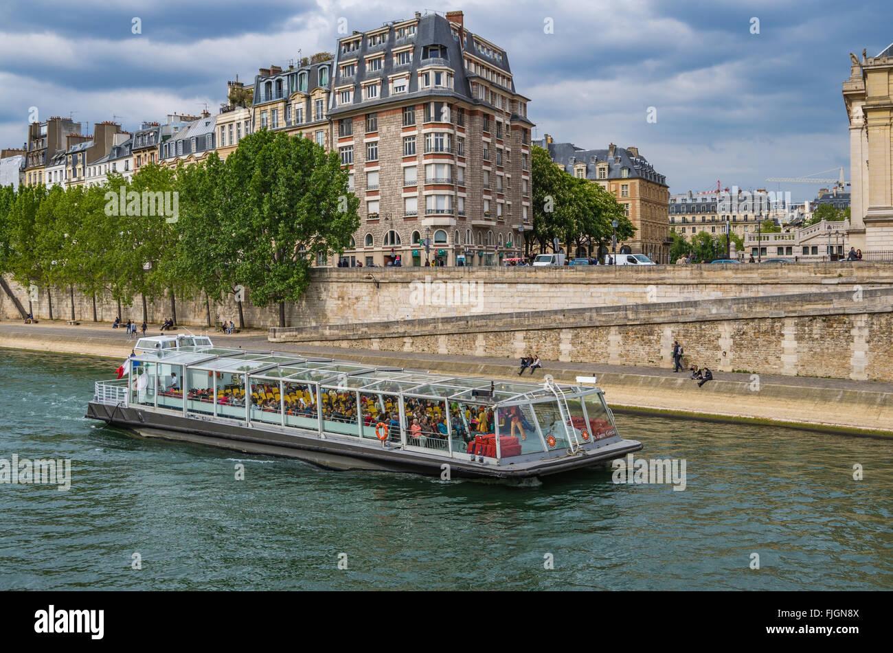 Paris France 2014 April 22,  Tour Boats cruising along the Seine River in Paris - Stock Image