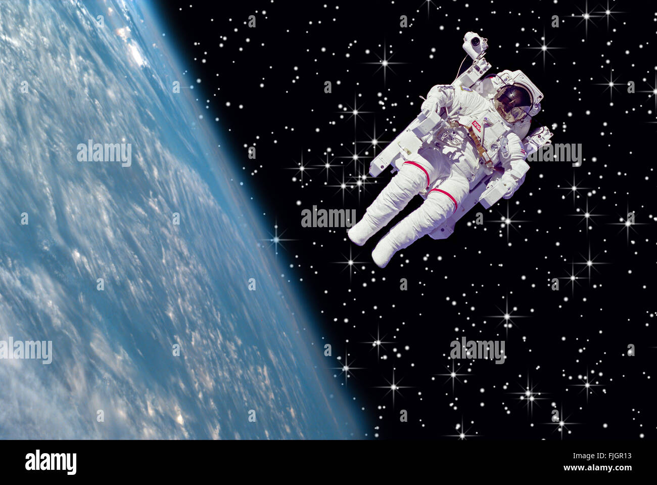 NASA image astronaut earth floating space stars - Stock Image