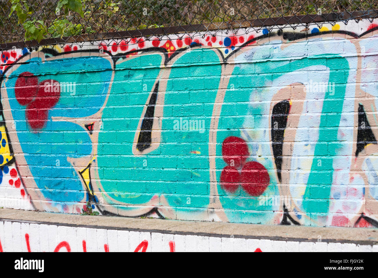 Fun - Graffiti on wall along Regents Canal towpath, London in February - Stock Image