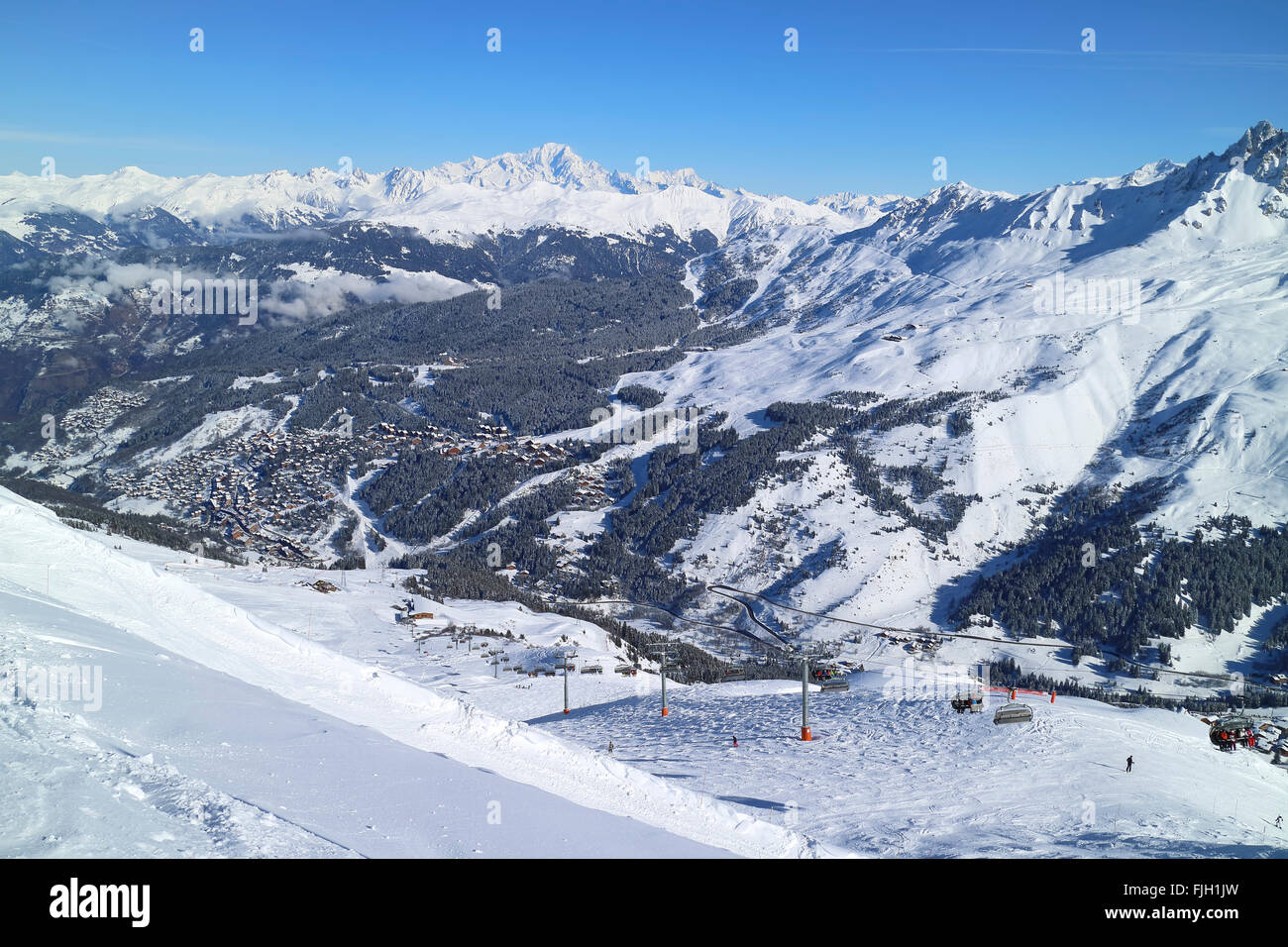 Ski village of Meribel in French Alps Three valleys ski resort, with ski slopes, lifts, chalets - Stock Image