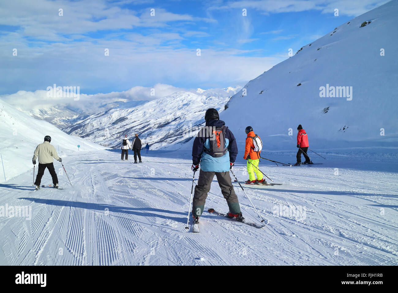 Skiing downhill in French Alps Three valleys ski resort on sunny winter day - Stock Image