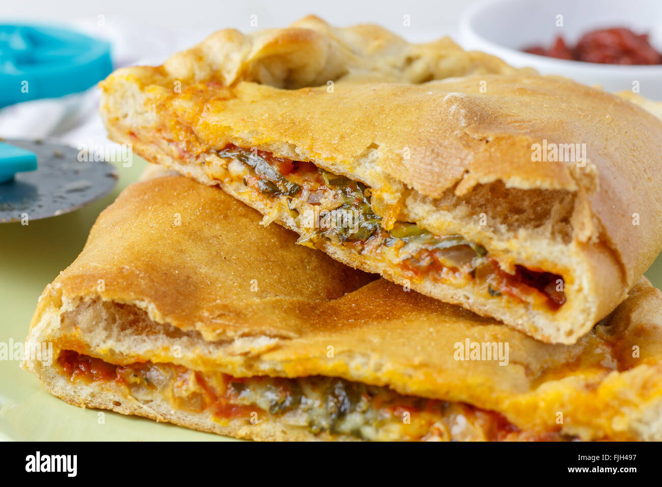 Calzone - Italian Oven-Baked Filled Pizza - Stock Image