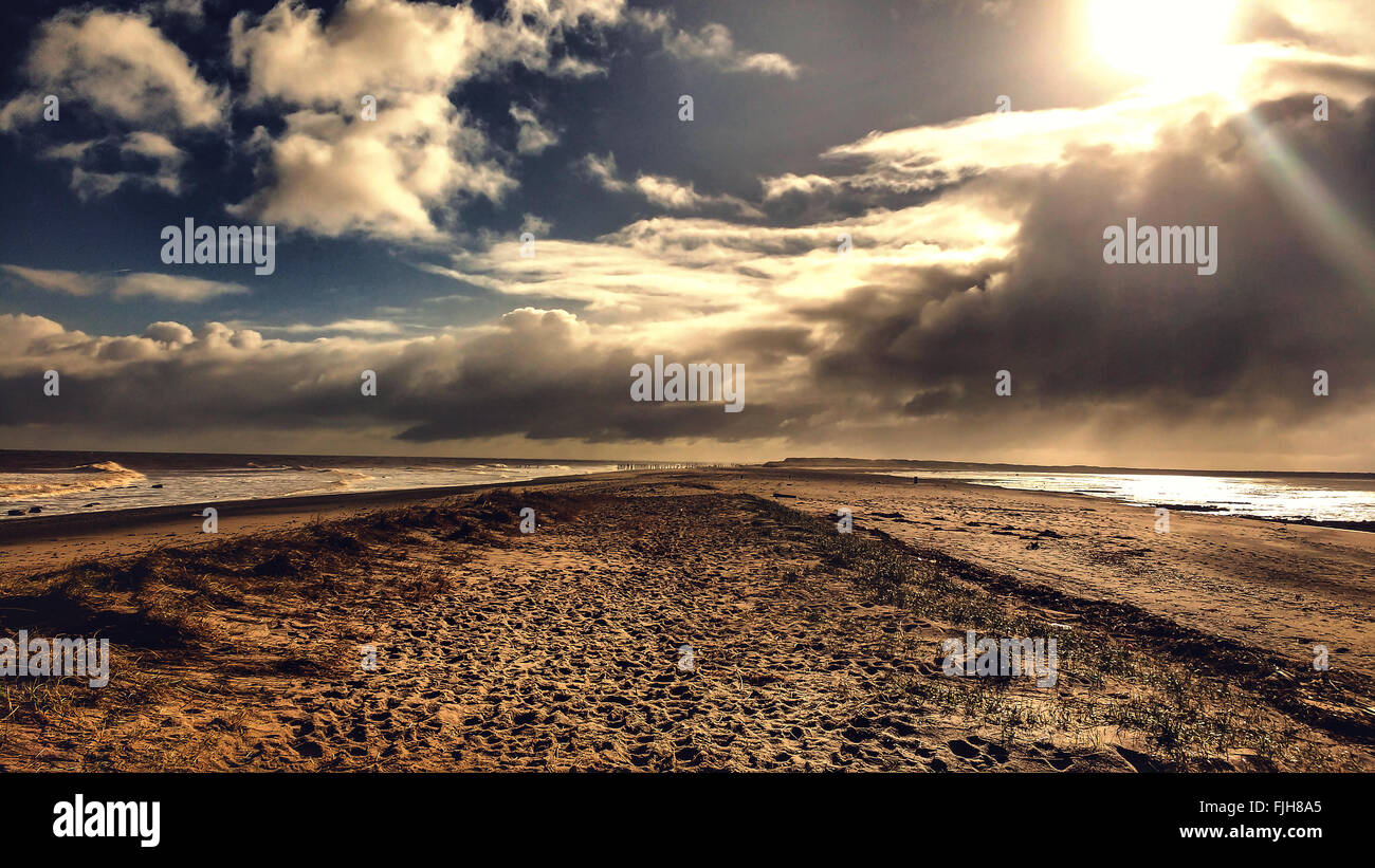 seaside landscape with dramatic sky - Stock Image