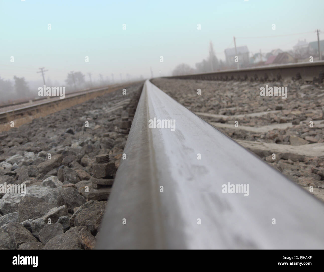 The rails, stretching to the horizon, photographed by a camera, placed on the rail head - Stock Image