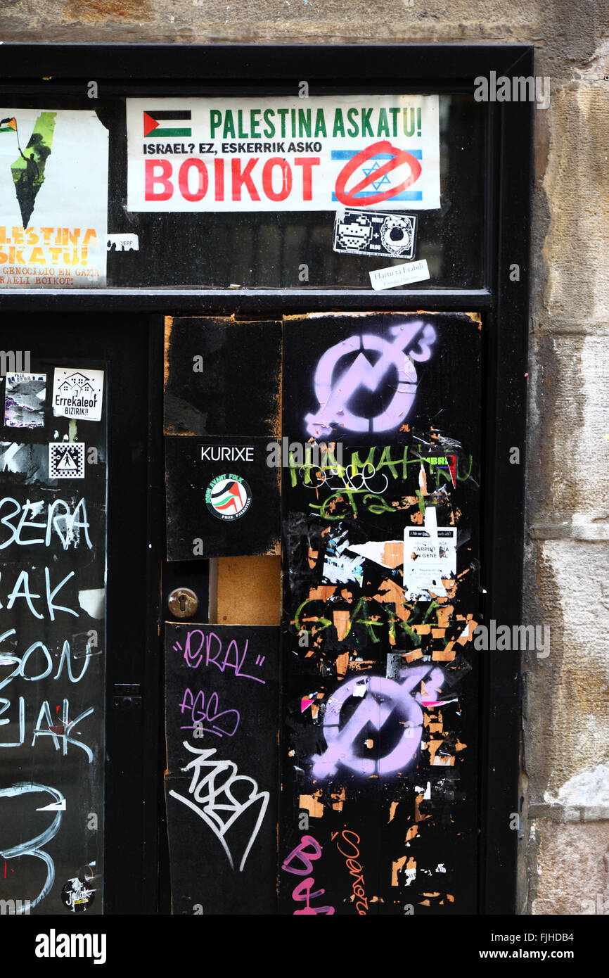 Free Palestine / anti Israel stickers in Basque language on a door in Caso Viejo, Bilbao, Basque Country, Spain - Stock Image