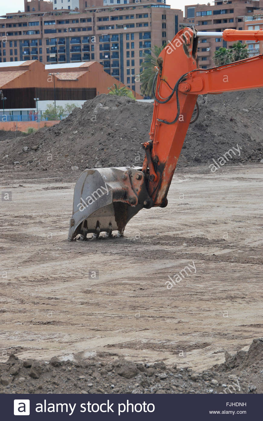 Close-up of excavator's bucket digging - Stock Image