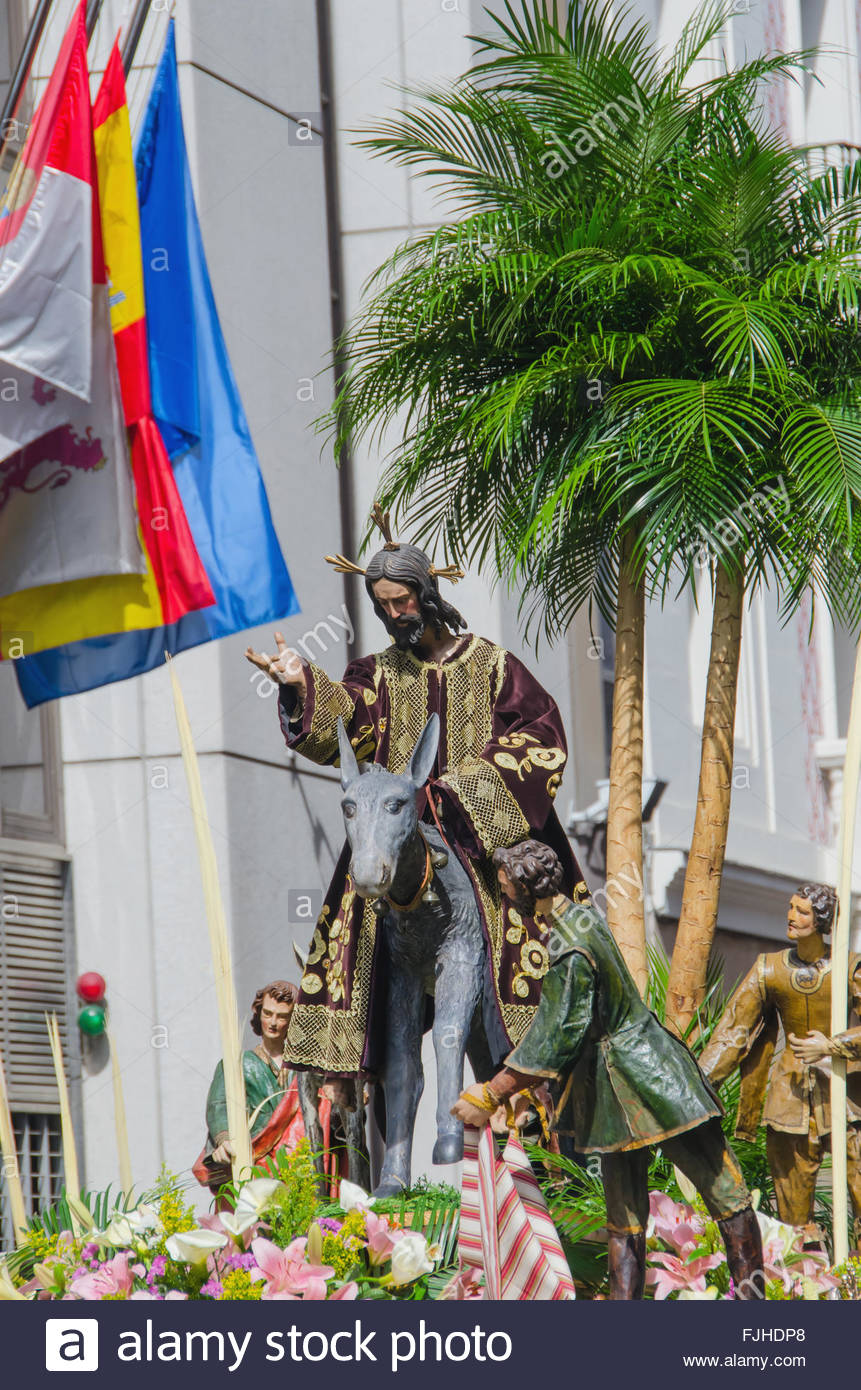 Sacred imagery in Valladolid's holy week procession. The Triumphal Entry of Jesus into Jerusalem also known - Stock Image