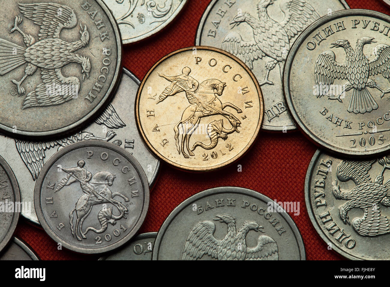 Coins of Russia. Saint George killing the Dragon depicted in the Russian kopek coins. - Stock Image