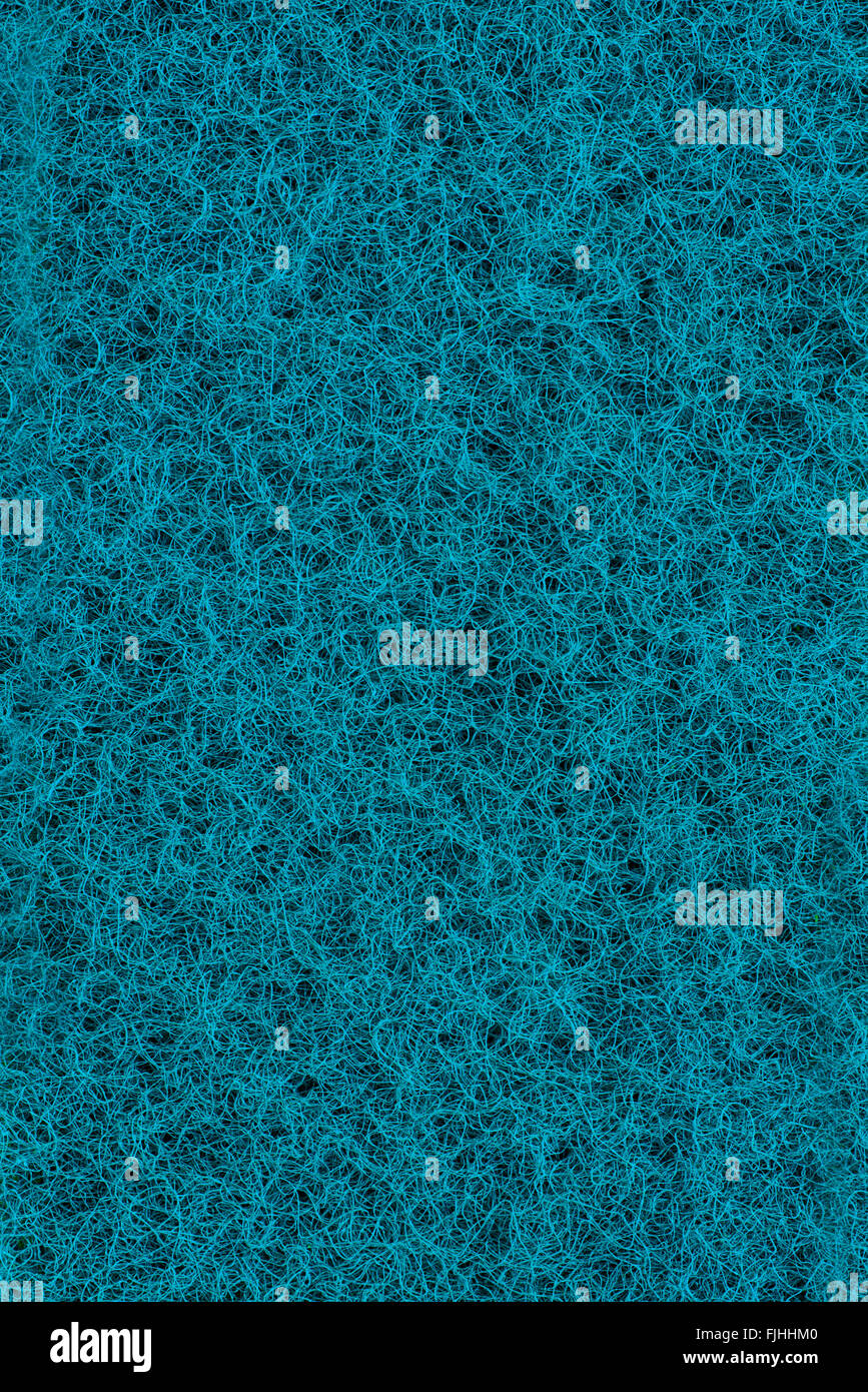 Cyan tangled texture. Scrubbing sponge fibre surface - Stock Image