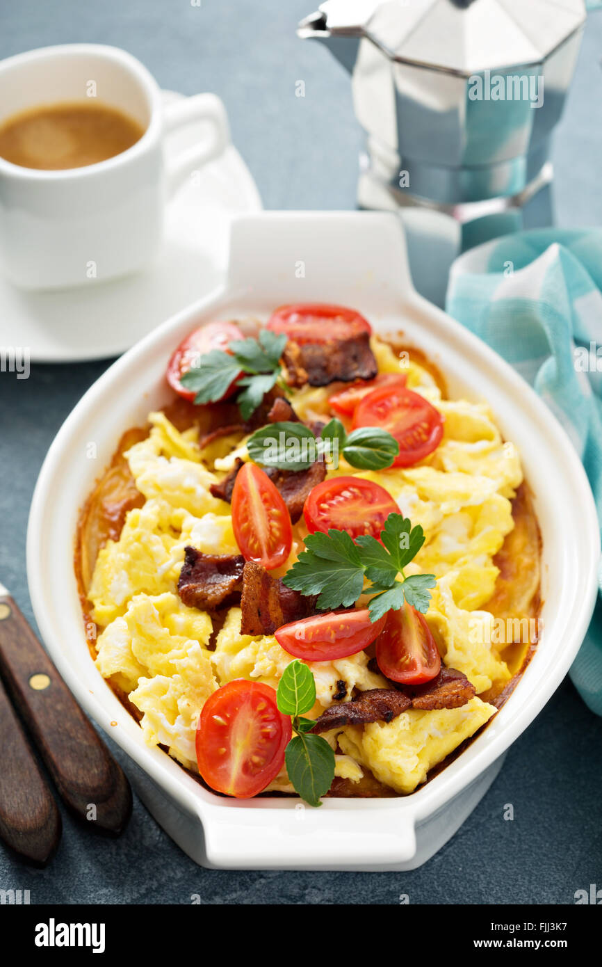 Baked potatoes with cheese sauce and eggs - Stock Image