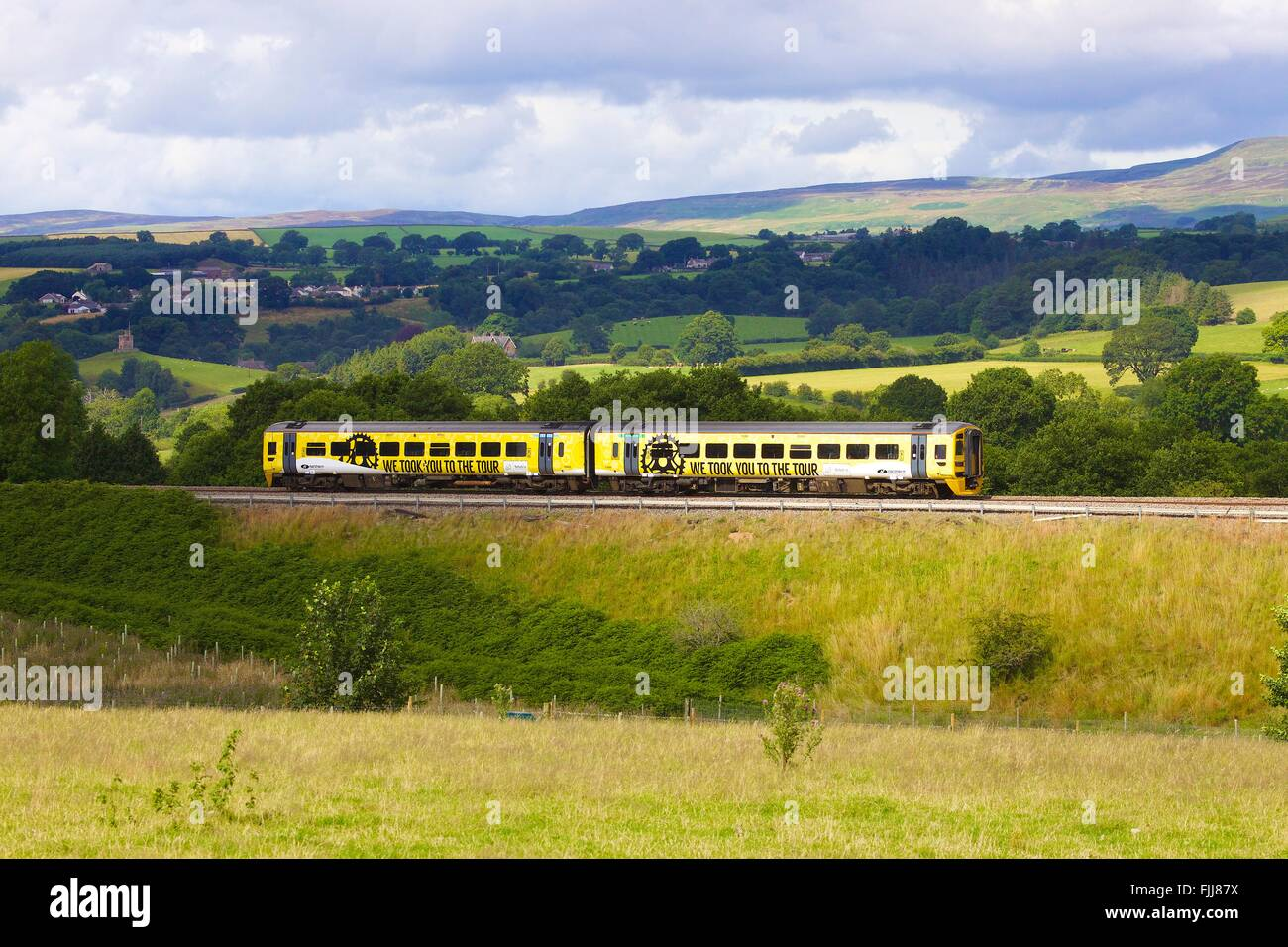 DMU Class 158 painted yellow by Northern Rail in honour of Tour de France in the Yorkshire Dales. Lazonby, Eden - Stock Image