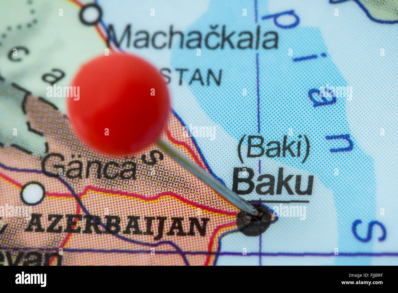Close-up of a red pushpin in a map of Baku, Azerbaijan. - Stock Image