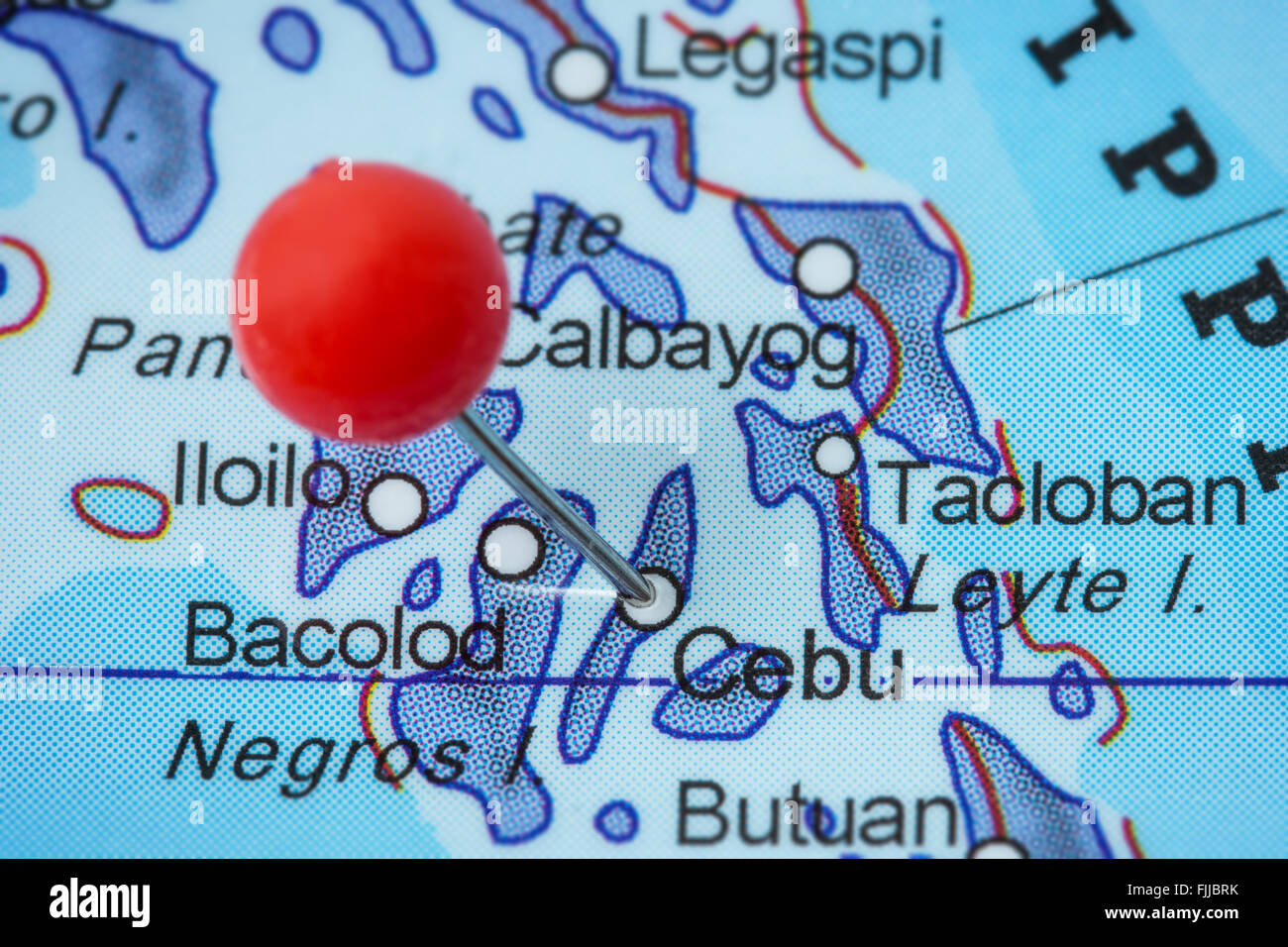 Close-up of a red pushpin in a map of Cebu, Philippines. - Stock Image