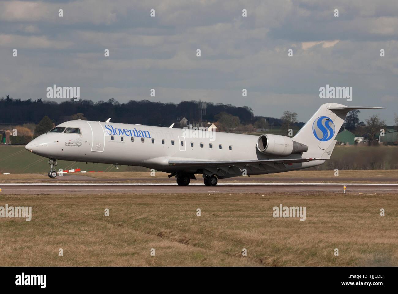 Canadair CL600 Slovenian Airlines landing LTN - Stock Image