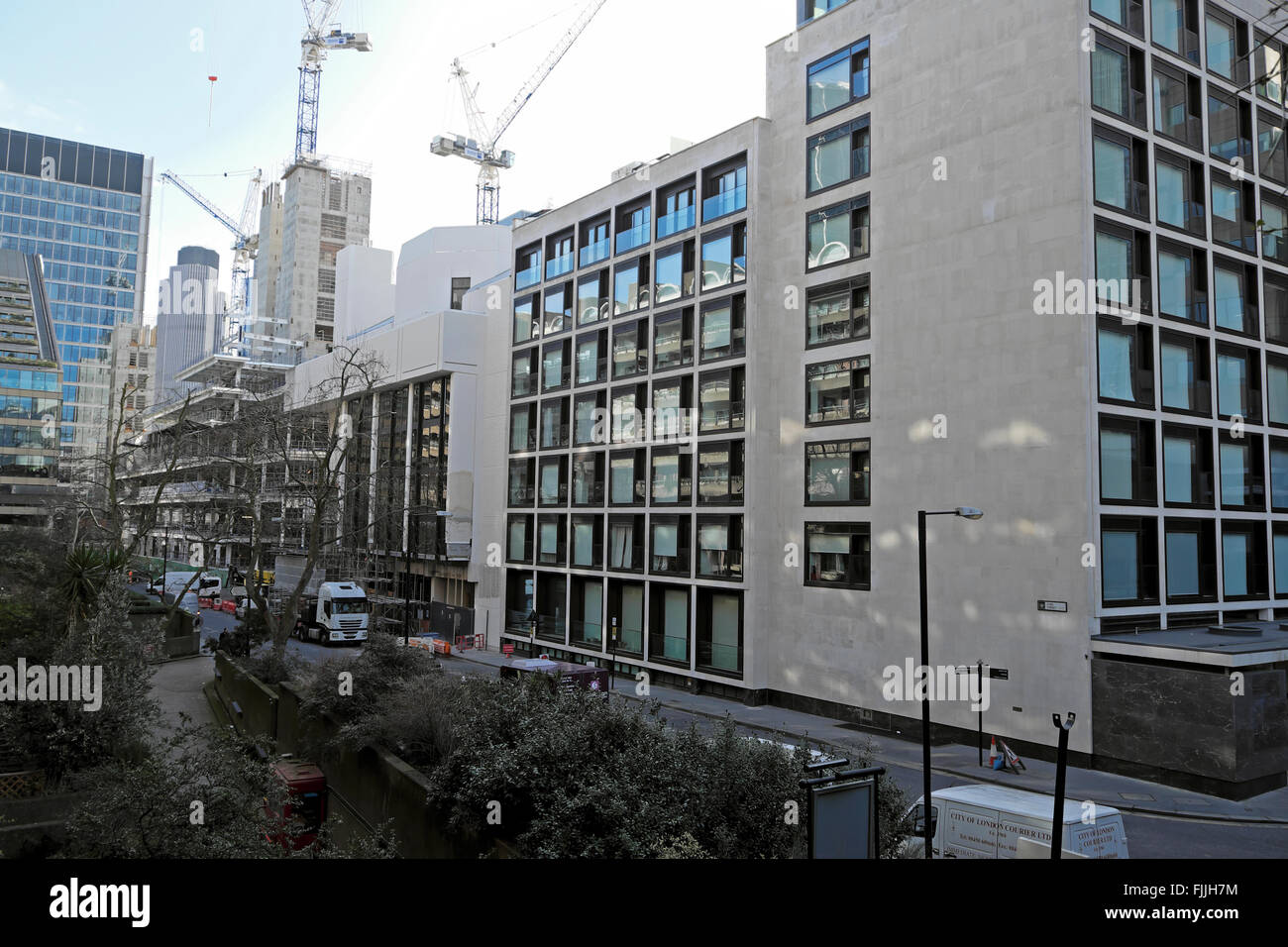 Cranes seen from Fore Street at  London Wall Place construction development site Moorgate London England UK    KATHY - Stock Image